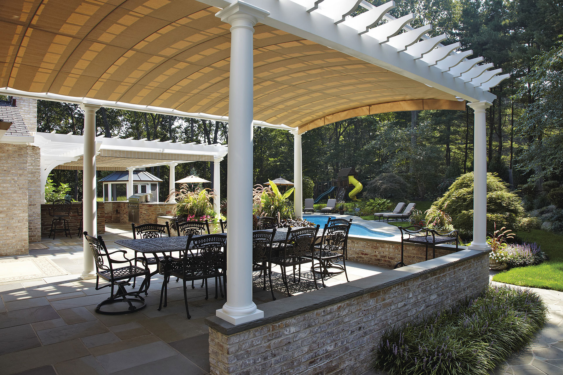 Arched Retractable Awnings in Oyster Bay | ShadeFX Canopies
