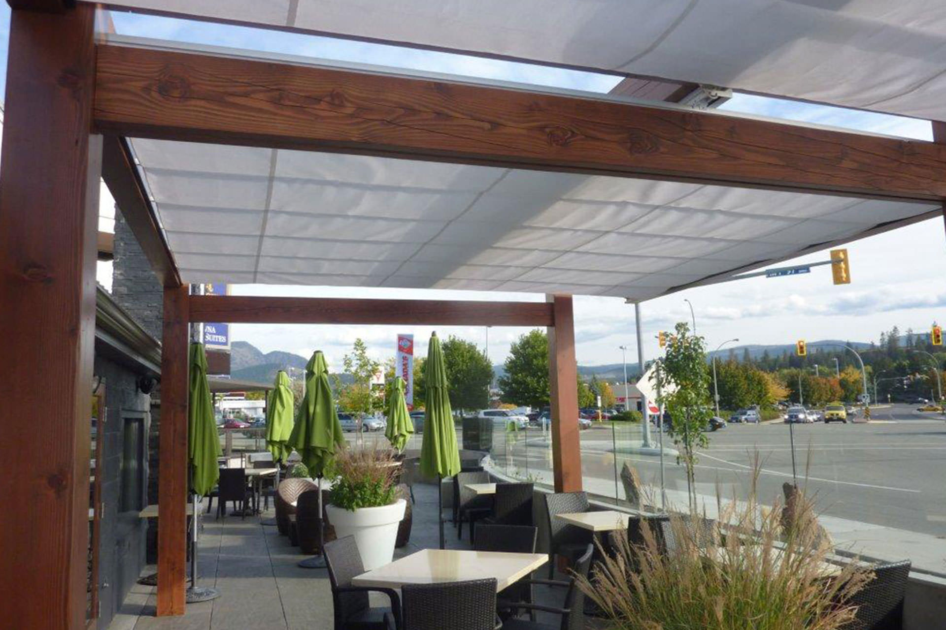 Outdoor Canopies Product : Cantilevered retractable canopies ora restaurant