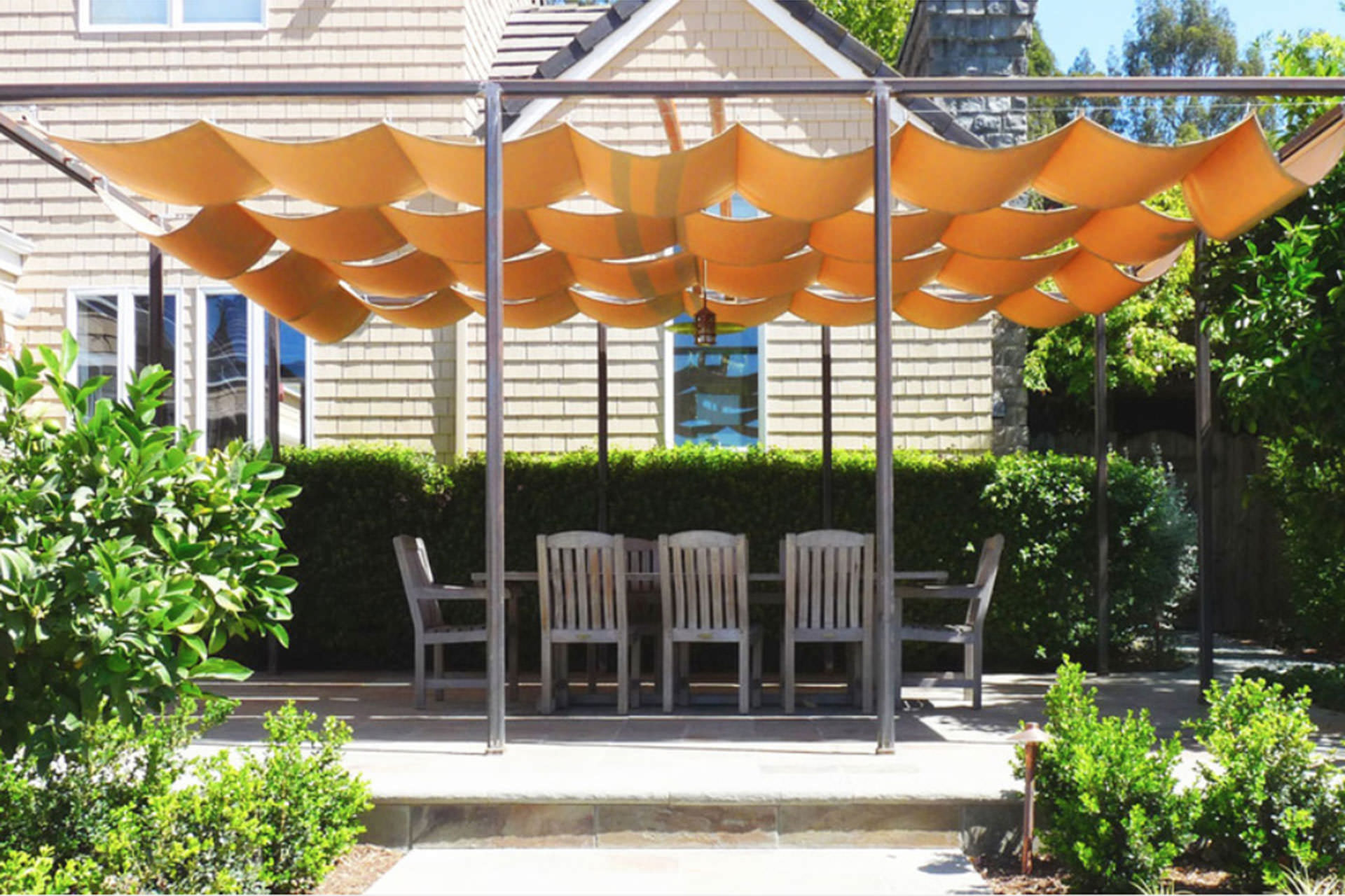 Backyard Awning Design : Choosing a Retractable Canopy Track Single, Multi, Cable, or Roll