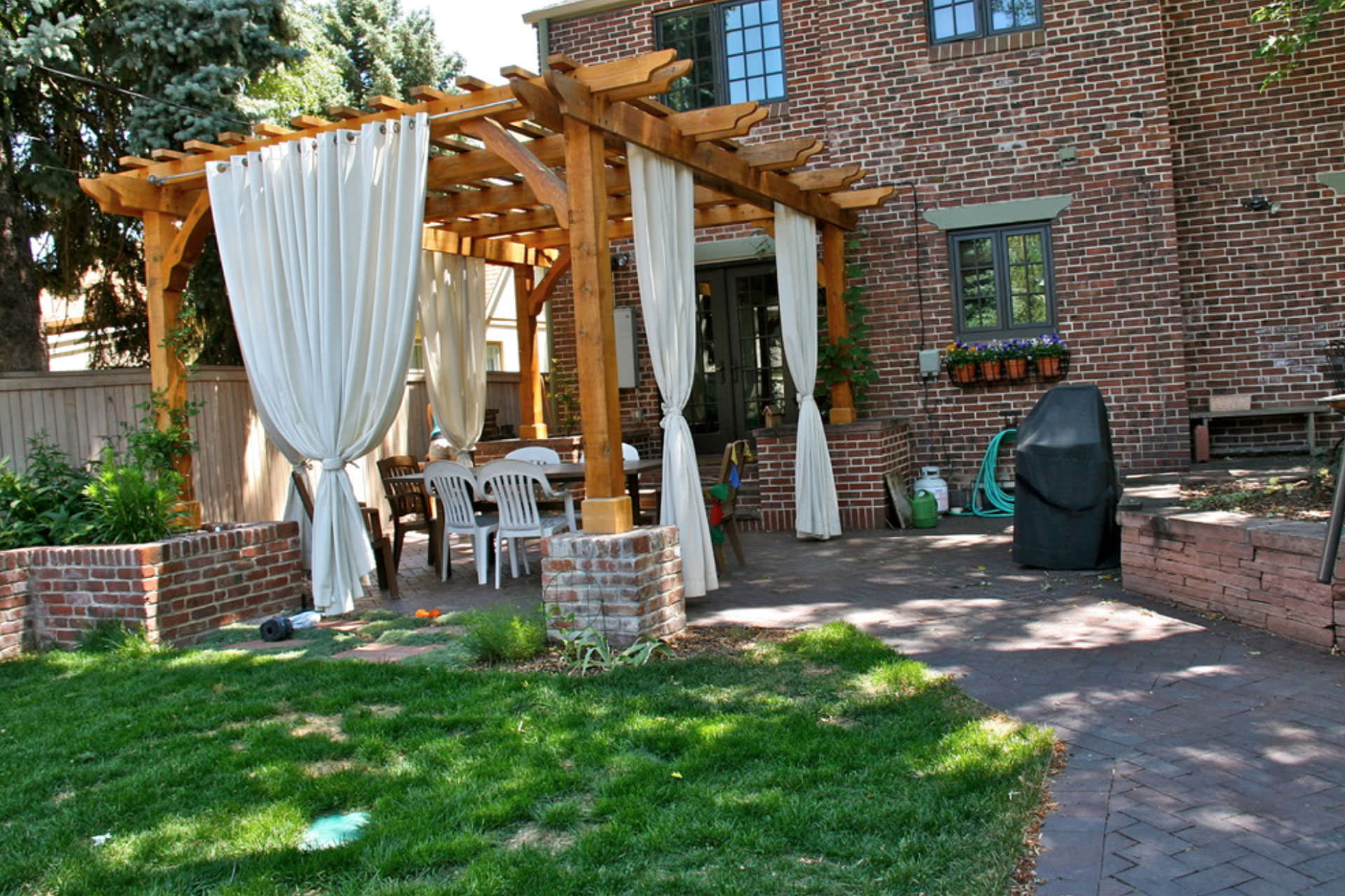 Pergola with White Curtains