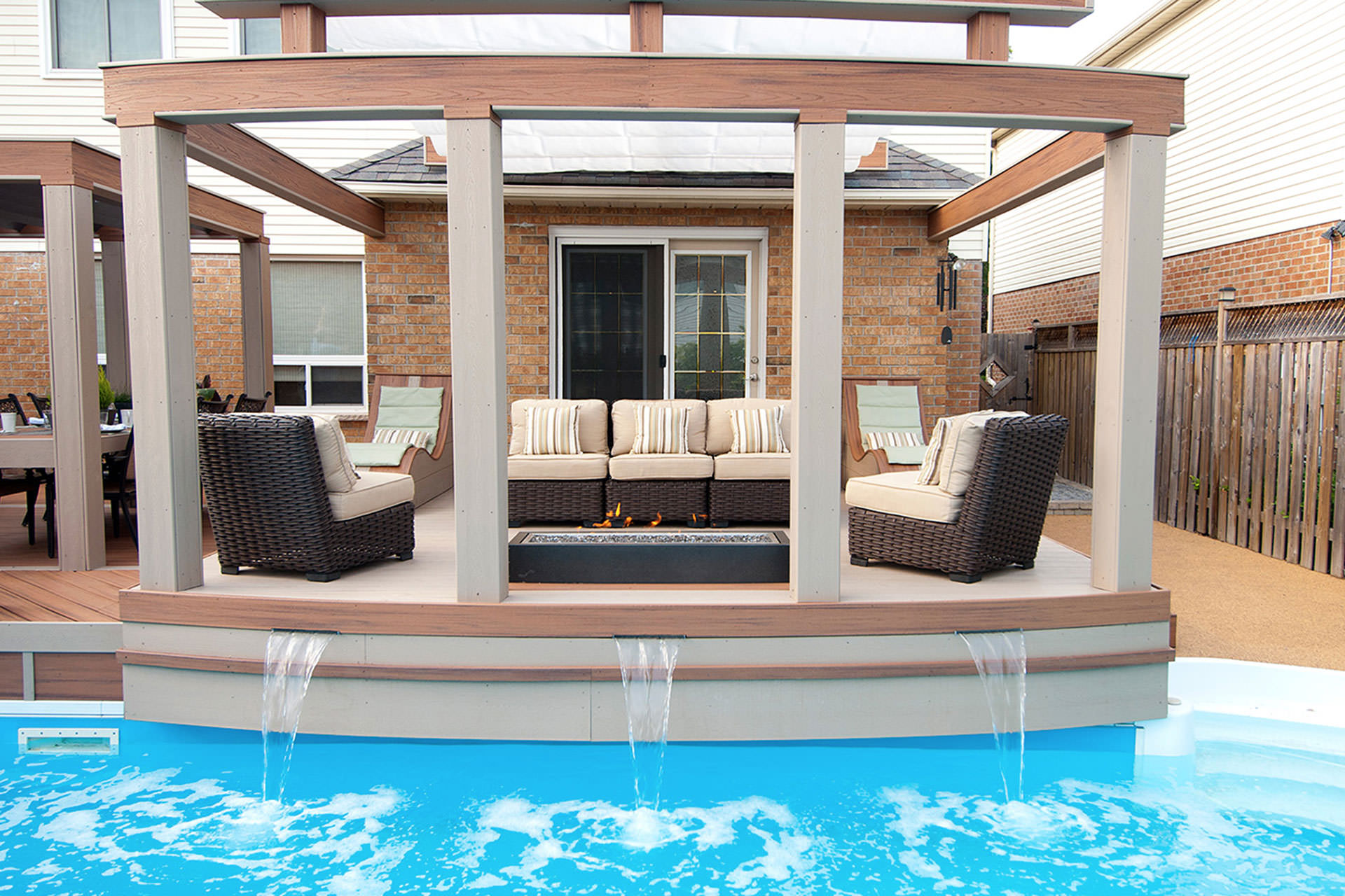 Retractable patio cover hgtv 39 s decked out for Pool design gmbh