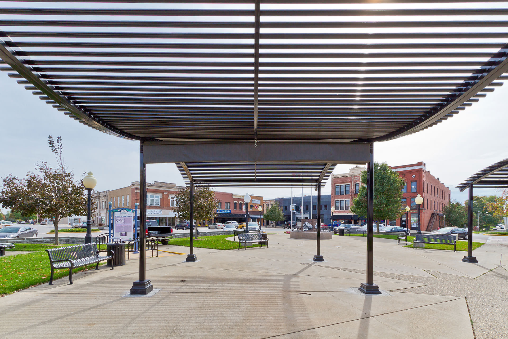 the city of clinton illinois transformed their public square with these cool multi functional structures equipped with retractable sun protection